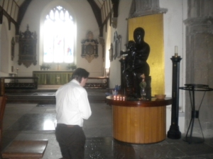 Praying before Our Lady of Willesden